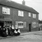 33. Kirks shop with Lois Kirkby and family group; possibly 1900; 580.jpg